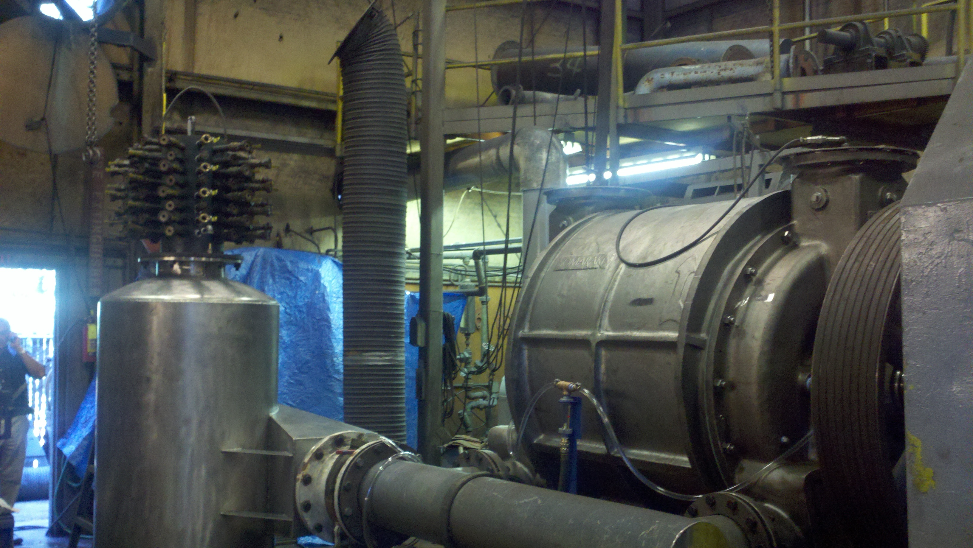 Hg vacuum  to 15 psi 316 stainless steel compressor being performance tested. Mechanical seals, petroleum application.